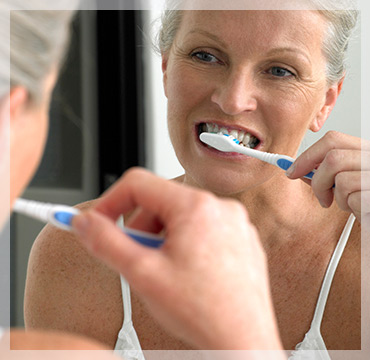 Elderly Woman Brushing Teeth Plaque Build Up parodontax